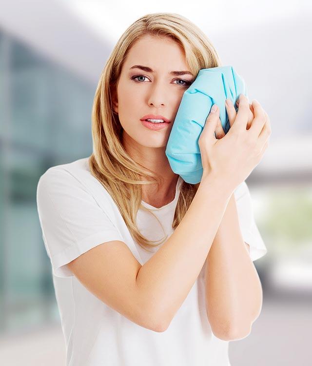 Šaltas kompresas apsaugo ištrauktą danties vietą nuo tinimo ir sustabdo arba sumažina kraujavimą